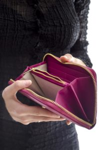 woman has empty wallet with no money to pay cash bonds